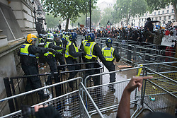 © Licensed to London News Pictures. 06/06/2020. London, UK. Police in riot gear protect Downing Street in Westminster, central London during a Black Lives Matter demonstration over the killing of African American George Floyd. The death of George Floyd, who died after being restrained by a police officer In Minneapolis, Minnesota, caused widespread rioting and looting across the USA. Photo credit: Ben Cawthra/LNP