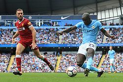 9th September 2017 - Premier League - Manchester City v Liverpool - Benjamin Mendy of Man City cross the ball beyond Jordan Henderson of Liverpool - Photo: Simon Stacpoole / Offside.