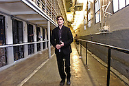 "Movie star Joaquin Phoenix walks through the main cellblock of the California State Penitentiary.  He was at the prison to perform songs from his hit move ""Walk the Line,"" about the life of Johnny Cash."