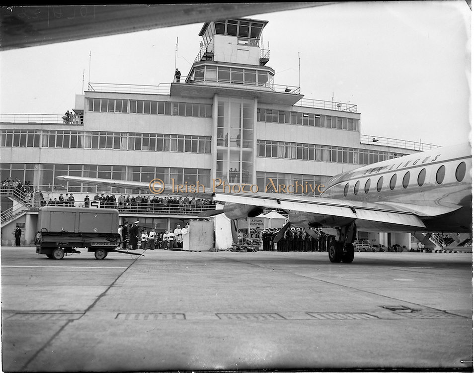 """05/06/1955<br /> 06/05/1955<br /> 05th June 1955<br /> Blessing of the Aer Lingus fleet at Dublin Airport. Image shows the procession from the terminal to the altar next to the aircraft """"Lorcan O Tuatail"""". note the band on right and altar in centre."""