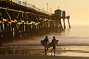 Surfers At The Pier