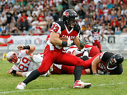 11.07.2011, UPC Arena, Graz, AUT, American Football WM 2011, Group B, Kanada (CAN) vs Oesterreich (AUT), im Bild Matt Walters (Canada, #33, RB) running with ball, Roman Meklau (Austria, #89, 54, DT) on the grass// during the American Football World Championship 2011 Group B game, Canada vs Austria, at UPC Arena, Graz, 2011-07-11, EXPA Pictures © 2011, PhotoCredit: EXPA/ E. Scheriau