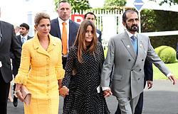 Mohammed bin Rashid Al Maktoum (right), Princess Haya bint Hussein (left) and daughter Sheikha Al Jalila during ladies day of the 2018 Investec Derby Festival at Epsom Downs Racecourse, Epsom.