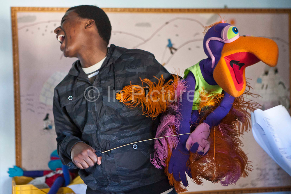 Lungelo sings with Vanda the vulture during a rehearsal of 'No Monkey Business', an AREPP: Theatre for Life production providing interactive social life skills education to schoolchildren through theatre productions. They are based in Johannesburg, South Africa and are about to go on tour for 3 months doing performances everyday at schools across the country.