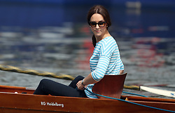 Duchess of Cambridge takes part in a rowing competition on the River Neckar during their visit to Heidelberg on the second day of their three-day tour of Germany.