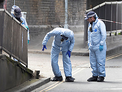 © Licensed to London News Pictures. 24/05/2021. London, UK. Police officers in protective suits conduct a search of Consort Road, Peckham in south London near where Black Lives Matter activist Sasha Johnson was shot. Ms Johnson remains in a critical condition in hospital after the shooting which happened at 3am on Sunday morning. Photo credit: Peter Macdiarmid/LNP