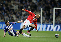 """PORTUGAL - PORTO 28 FEBRUARY 2005: """"MANICHE"""" Nuno Ricardo Oliveira Ribeiro #18(L) and MANUEL DOS SANTOS #18(R), in the 23 leg of the Portuguese soccer league """"Super Liga"""" FC Porto (1) vs SL Benfica (1), held in """"Dragao"""" stadium  28/02/2005  21:10:16<br />(PHOTO BY: NUNO ALEGRIA/AFCD)<br /><br />PORTUGAL OUT, PARTNER COUNTRY ONLY, ARCHIVE OUT, EDITORIAL USE ONLY, CREDIT LINE IS MANDATORY AFCD-PHOTO AGENCY 2004 © ALL RIGHTS RESERVED"""