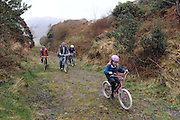 REPRO FREE: 10-4-2014: €3.4m greenway for South Kerry.<br /> <br /> Junior Transport Minister Alan Kelly pictured with Ronan Clifford, Michael and Elaine Kavanagh from Kells, County Kerry cycling on the old Glenbeigh to Cahersiveen Railway line on Thursday after he launched  a €3.4m greenway development for South Kerry. <br /> The Glenbeigh Greenway will facilitate walkers and cyclists and stretch 26 kilometres from Glenbeigh to Caherciveen and Renard and will be routed along the old railway line. The route includes travelling through train tunnels,  crossing over the magnificient Gleesk Viaduct all along the Wild Atlantic Way with the most spectacular scenery in Ireland overlooking Dingle Bay.<br /> Picture by Don MacMonagle<br /> <br /> FREE REPRO
