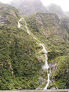 Waterfalls in the vicinity of Milford Sound, Fiordland National Park, New Zealand, after a heavy rain event.