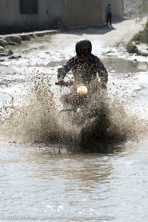 Beanre (Kevin Doebler) encountering a flooded piece of road on day-4 of our Himalayan Heroes adventure riding from Pokhara to Kalopani, Nepal. Friday, November 9, 2018. Photography ©2018 Michael Lichter.