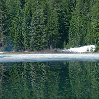 Campers on the banks of Independence Lake in the Mt. Baker-Snoqualmie National Forest in Washington.  This easy 1.6-mile round trip hike heads through old-growth forest and leads to a beautiful green lake.  Photo by William Byrne Drumm.