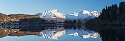 Snow in the mountains. West coast of Norway, nearby Ålesund  | Snø i fjella, med refleksjon i Storevalen. Solavågen med Leirvåg og Sunde.