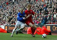 Photo: Andrew Unwin.<br />Liverpool v Everton. The Barclays Premiership. 25/03/2006.<br />Liverpool's John Arne Riise (R) battles with Everton's Tony Hibbert (L).