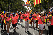 """Demonstrator wearing a tshirt with republican logos holding a banner writed """"freddom for political prisoners' in Catalan language. The Diada in Barcelona, the 11th of September is the Catalan day and many manifestation have been held in the Catalan Capital, including many demontration asking independecy from Spain and liberation of separatis polititians incarcerated after helding an inllegal unilateral referendum last year. Barcelona, Spain. September 11th, 2018."""