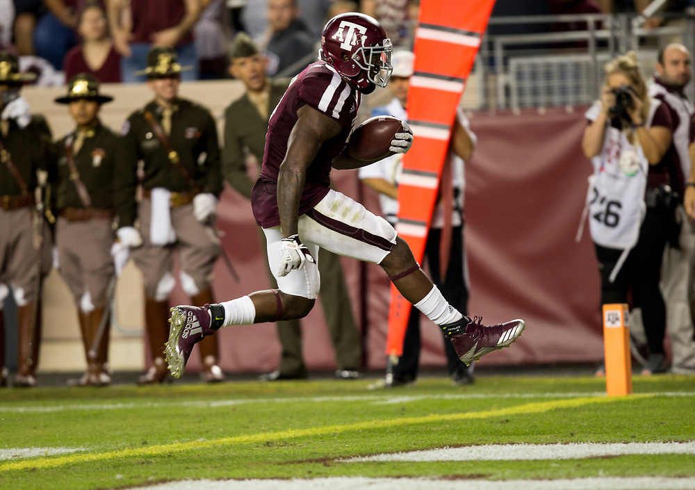 Texas A&M running back Keith Ford (7) skips over the goal line for a touchdown after a 12 yard run against New Mexico during the second quarter of an NCAA college football game on Saturday, Nov. 11, 2017, in College Station, Texas. (AP Photo/Sam Craft)