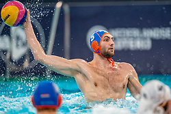 Guus van IJperen of the Netherlands in action against Montenegro during the Olympic qualifying tournament. The Dutch water polo players are on the hunt for a starting ticket for the Olympic Games on February 19, 2021 in Rotterdam