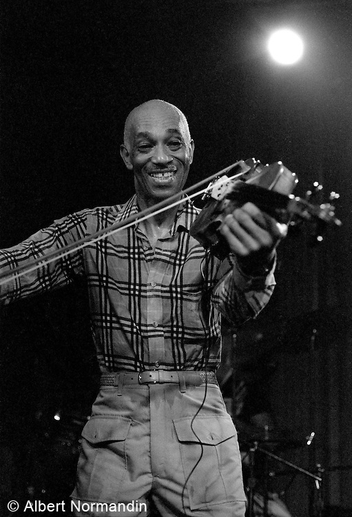 Papa John Creach playing violin and smiling to camera