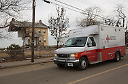 Union Beach NJ, November 16, A Red Cross truck passes a home on Front Street destroyed by superstorm Sandy's surge, that damaged over 200 homes in Union Beach alone. Hurricane Sandy's strength is being blamed on climate change by many scientists.