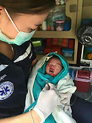 PARAMEDICS FIND BABY BOY CRYING AFTER MUM DIED IN CHILDBIRTH<br /> <br /> This is the heartbreaking moment a tiny newborn baby was found crying and covered in blood after his mother died during childbirth. <br /> <br /> Single mum Nong Parichat, 24, suddenly went into labour earlier this month at her home in Pathu Thani, Thailand.<br /> <br /> She was in agony and suffered horrific blood loss as she battled to deliver the baby on her own on her living room floor.<br /> <br /> Eventually she called an ambulance but tragically it arrived too late and shocked paramedics found the mother passed out on the ground at around 9pm. <br /> <br /> The baby was rushed to hospital and is currently being cared for by nurses at a children's hospital in the Thai capital.<br /> <br /> Volunteer rescue worker Eyeuam Thong said: ''The mother have the baby her last breath. She was found dead but the child survived.<br /> <br /> ''There was  blood everywhere on the floor and the mother had suffered some kind of internal hemorrhage of bleeding. <br /> <br /> ''She gave birth on her own. There was nobody else around. She called an ambulance herself before the baby came but it was too late.<br /> <br /> ''It's a sad, sad situation for everybody. The baby will grow up without a mum or dad. He's being looked after by nurses and after that he could be fostered or adopted.''<br /> ©Exclusivepix Media