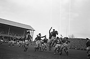 W J McBride, Ireland, leaps highest in this lineout near the Wales line,..Irish Rugby Football Union, Ireland v Wales, Five Nations, Landsdowne Road, Dublin, Ireland, Saturday 17th November, 1962,.17.11.1962, 11.17.1962,..Referee- J A E Taylor, Scottish Rugby Union, ..Score- Ireland 3 - 3 Wales, ..Irish Team, ..T J Kiernan,  Wearing number 15 Irish jersey, Full Back, University college Cork Football Club, Cork, Ireland,  ..W R Hunter, Wearing number 14 Irish jersey, Right Wing, C I Y M S Rugby Football Club, Belfast, Northern Ireland, ..A C Pedlow, Wearing number 13 Irish jersey, Right Centre,  C I Y M S Rugby Football Club, Belfast, Northern Ireland, ..M K Flynn, Wearing number 12 Irish jersey, Left Centre, Wanderers Rugby Football Club, Dublin, Ireland, ..N H Brophy, Wearing number 11 Irish jersey, Left wing, London Irish Rugby Football Club, Surrey, England, ..M A English, Wearing number 10 Irish jersey, Stand Off, Landsdowne Rugby Football Club, Dublin, Ireland, ..J C Kelly, Wearing number 9 Irish jersey, Scrum Half, University College Dublin Rugby Football Club, Dublin, Ireland, ..M P O'Callaghan, Wearing number 1 Irish jersey, Forward, Sundays Well Rugby Football Club, Cork, Ireland, ..A R Dawson, Wearing number 2 Irish jersey, Forward, Wanderers Rugby Football Club, Dublin, Ireland, ..P J Dwyer, Wearing number 3 Irish jersey, Forward, University College Dublin Rugby Football Club, Dublin, Ireland, ..W J McBride, Wearing number 4 Irish jersey, Forward, Ballymena Rugby Football Club, Antrim, Northern Ireland,..W A Mulcahy, Wearing number 5 Irish jersey, Captain of the Irish team, Forward, Bective Rangers Rugby Football Club, Dublin, Ireland,  ..P J A O'Sullivan, Wearing  Number 6 Irish jersey, Forward, Galwegians Rugby Football Club, Galway, Ireland, ..C J Dick, Wearing number 8 Irish jersey, Forward, Ballymena Rugby Football Club, Antrim, Northern Ireland, ..M D Kiely, Wearing number 7 Irish jersey, Forward, Landsdowne Rugby Football Club, Dublin, Ireland, ..W