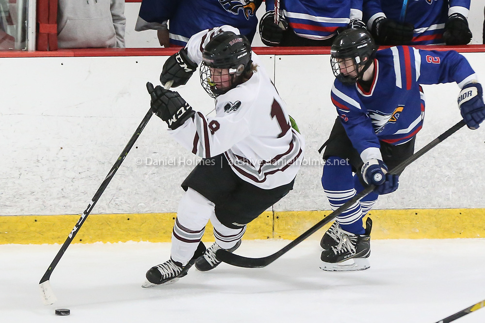 (1/6/20, MARLBOROUGH, MA) Northbridge's Nick Locurto digs the puck out from the boards during the Russell Conference matchup against Hopedale-Millis at New England Sports Center in Marlborough on Monday. [Daily News and Wicked Local Photo/Dan Holmes]