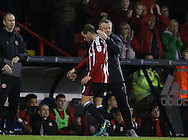 Chris Wilder manager of Sheffield Utd  replaces Billy Sharp of Sheffield Utd during the English League One match at Bramall Lane Stadium, Sheffield. Picture date: December 10th, 2016. Pic Simon Bellis/Sportimage
