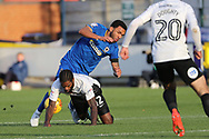 AFC Wimbledon striker Andy Barcham (17) battles for possession with Peterborough United midfielder Anthony Grant (42) during the EFL Sky Bet League 1 match between AFC Wimbledon and Peterborough United at the Cherry Red Records Stadium, Kingston, England on 12 November 2017. Photo by Matthew Redman.