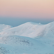 Puy de l' angle covered with snow in sunset