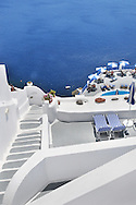 Santorini is an island in the southern Aegean Sea, about 200 km (120 mi) southeast of Greece's mainland. It is the largest island of a small, circular archipelago which bears the same name and is the remnant of a volcanic caldera. It forms the southernmost member of the Cyclades group of islands.