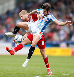 Adam Clayton of Middlesbrough is challenged by Jacob Butterfield of Huddersfield - Photo mandatory by-line: Rogan Thomson/JMP - 07966 386802 - 13/09/2014 - SPORT - FOOTBALL - Huddersfield, England - The John Smith's Stadium - Huddersfield town v Middlesbrough - Sky Bet Championship.