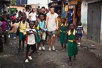 One Direction with children from Queensland school Agbogbloshie slum, Accra