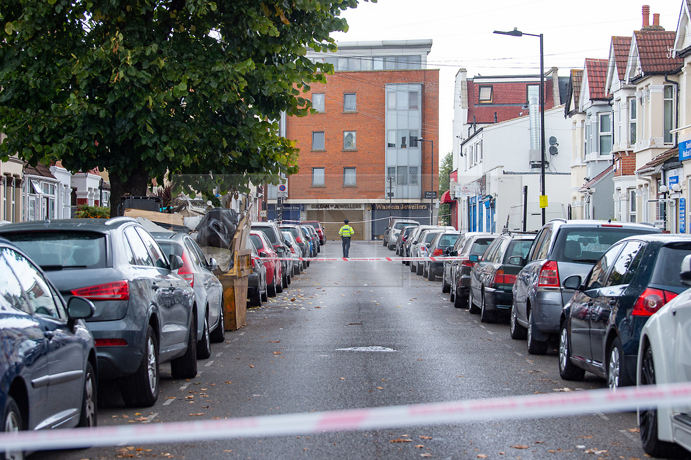 © Licensed to London News Pictures. 23/09/2019. London, UK. A Metropolitan Police officer stands at a cordon on Abbotts Road, approximately 150 meters away a man in his 20's was found injured outside a shop in The Broadway, Southall. The man was taken to hospital suffering from a stab injury; he we was pronounced dead at 05:26 BST Photo credit: Peter Manning/LNP