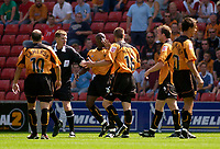 Photo. Glyn Thomas , Digitalsport<br /> Stoke City v Wolverhampton Wanderers. <br /> Coca Cola Championship. 08/08/2004.<br /> Wolves' Kenny Miller (third from R) fights with teammate Shaun Newton (third from L).
