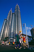 Women playing basketball in Kuala Lumpur by the Petronas Towers in Malaysia.