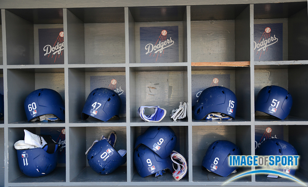 Sep 6, 2016; Los Angeles, CA, USA; Batting helmets of Los Angeles Dodgers right fielder Andrew Toles (60), left fielder Howie Kendrick (47), catcher Austin Barnes (15), catcher Carlos Ruiz (51), second baseman Micah Johnson (11), third baseman Justin Turner (10), catcher Yasmani Grandal (9), shortstop Charlie Culberson (6) and left fielder Enrique Hernandez (14) in the dugout during a MLB game against the Arizona Diamondbacks at Dodger Stadium.
