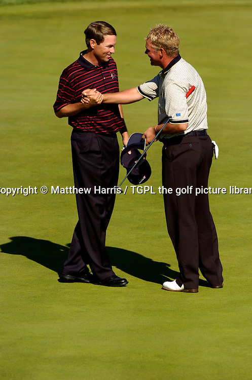 Davis LOVE III (USA) shakes hands with Darren CLARKE (EUR) having halved their match at 18th during final day Singles of the Ryder Cup Matches 2004,Oakland Hills (South Course),Bloomfield,Michigan,USA.