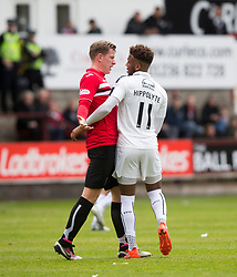 Dunfermline's Lee Ashcroft after a tackle by Falkirk's Nathan Austin. Dunfermline 1 v 2 Falkirk, Scottish Championship game played 22/4/2017 at Dunfermline's home ground, East End Park.