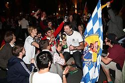 23.06.2010, Leopoldstrasse Schwabing, Muenchen, GER, FIFA Worldcup, Fanfeier nach Ghana vs Deutschland,  im Bild fans auf den Knien mit Pokal und Bayernflagge , EXPA Pictures © 2010, PhotoCredit: EXPA/ nph/  Straubmeier