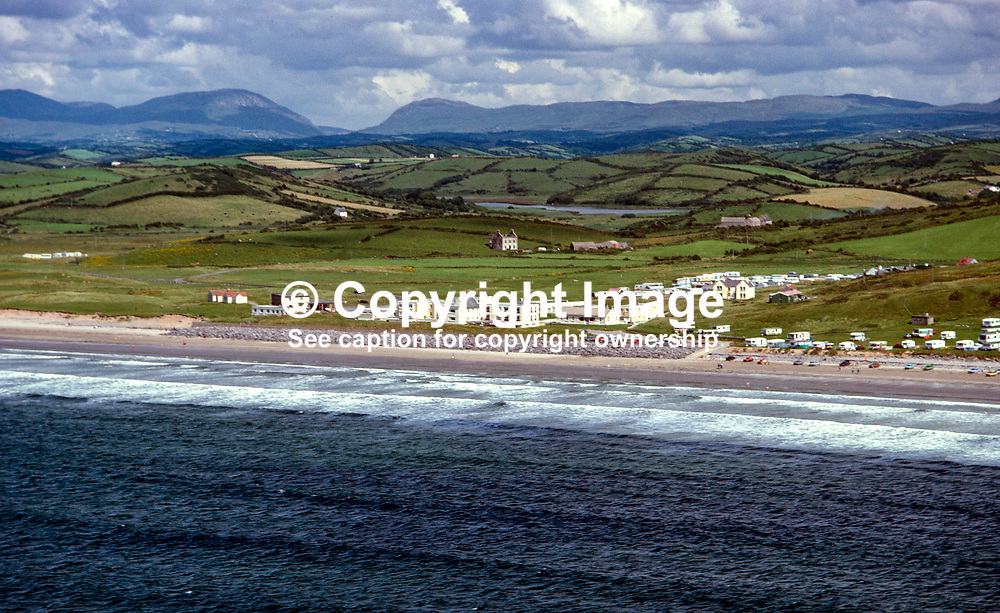 Aerial photograph, Rossnowlagh, Ballyshannon, Co Donegal, Rep of Ireland. In the distance is Barnesmore Gap. 19790160a.<br /> <br /> Copyright Image from Victor Patterson, Belfast, UK<br /> <br /> t: +44 28 9066 1296 (from Rep of Ireland 048 9066 1296)<br /> m: +44 7802 353836<br /> e: victorpattersonbelfast@gmail.com<br /> <br /> www.images4media.com<br /> <br /> Please see my full Terms and Conditions of Use at https://www.images4media.com/p/terms-conditions - it is IMPORTANT that you familiarise yourself with them.<br /> <br /> Images used online incur an additional cost. This cost should be agreed in writing in advance. Online images must be visibly watermarked i.e. © Victor Patterson or that of the named photographer within the body of the image. The original metadata must not be deleted from images used online.<br /> <br /> This image is only available for the use of the download recipient i.e. television station, newspaper, magazine, book publisher, etc, and must not be passed on to a third party. It is also downloaded on condition that each and every usage is notified within 7 days to victorpattersonbelfast@gmail.com.<br /> <br /> The right of Victor Patterson (or the named photographer) to be identified as the author is asserted in accordance with The Copyright Designs And Patents Act (1988). All moral rights are asserted.