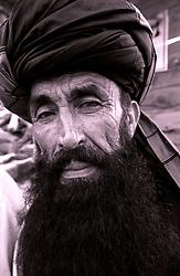 Khost, 20 August 2005..Portrait of Afghan man wearing a black turban