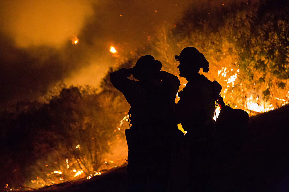 Firefighters of Rogue River District #1, Oregon Fire Department, talk about their plan for stopping the wildfire behind them. These firefighters came from Oregon to stop the wildfire occurred in Ojai, California for 20 days.   On Thursday, December 7th, 2017 at Camp Ramah in California in Ojai, California. (Photo by Yuki Iwamura)