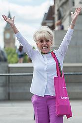 © Licensed to London News Pictures. 08/08/2016. London, UK. Dame Barbara Windsor joins Team London Ambassadors in Trafalgar Square to welcome visitors from around the world to the capital, showing London is open to all.  Continuing their good work from the London 2012 Olympics, more than 500 Team London Ambassadors have volunteered, as part of the Mayor of London's annual Visitor Welcome programme, to help visitors get the most out of the capital at key tourist hotspots. Photo credit : Stephen Chung/LNP