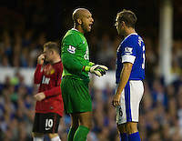 Everton's Tim Howard and Phil Jagielka ..Football - Barclays Premiership - Everton v Manchester United - Monday August 20th 2012 - Goodison Park - Liverpool..