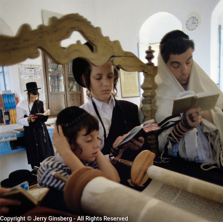 Father and his sons praying together in the Kosov Synagogue in Tsfat (Safed), Israel.