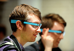 File photo dated 23/06/14 of Gerald Lynch (left) and Kane Fulton trying Google Glass during the launch in north London. Google Glass has made a surprise comeback after the augmented reality headset's companion app was given its first update in almost three years.
