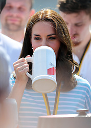 The Duchess of Cambridge with a German beer after taking part in a rowing competition on the River Neckar during a visit to Heidelberg on the second day of her three-day tour of Germany.