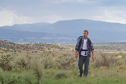 All American, masculine Man backpacking in Abiquiu, New Mexico
