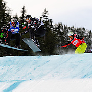 Snowboard-Cross racers Francois Boivin (16 - CAN) and Lukas Gruener (8 - AUT) battle during semi-final race action at the 2009 LG Snowboard FIS World Cup on February 13th, 2009 at Cypress Mountain, British Columbia. Mandatory Photo Credit: Bella Faccie Sports Media\Thomas Di Nardo. Contact: Thomas Di Nardo, Snohomish, Washington, USA. Telephone 425-260-8467. e-mail: tom@bellafaccie.com