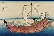 Two trading vessels under sail, view of Mount Fuji in distance.  From 'Thirty-six Views of Mount Fuji', c1831. Katsushika Hokusai (1760-1849) Japanese Ukiyo-e artist.  Seascape Japan Transport Trade Shipping Sail