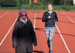 © Licensed to London News Pictures. 29/03/2020. London, UK. People exercising at Paddington Recreation Ground in London, in the early morning sun, during a lockdown over the Coronavirus spread. Members of the public have been told they can only leave their homes to exercise briefly once a day, and to go to shops for essentials when absolutely necessary, in an attempt to fight the spread of COVID-19. Photo credit: Ben Cawthra/LNP